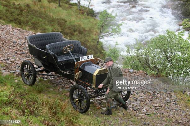 Neil Tuckett begins his attempt to drive a 1911 Model T Ford to the top of Ben Nevis on May 162011 in Fort William Scotland The challenge has been...