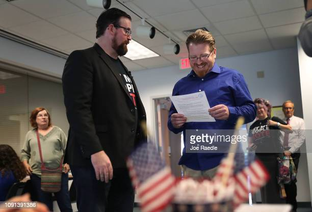 Neil Volz and Lance Wissinger prepare to fill out their voter registration forms at the Lee Country Supervisor of Elections office on January 08 2019...