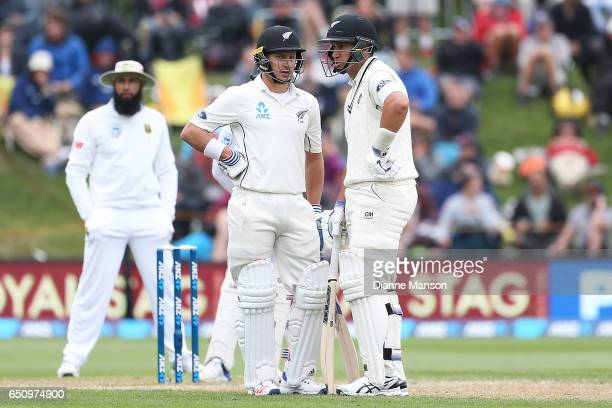Neil Wagner and Ross Taylor of New Zealand bat during day three of the First Test match between New Zealand and South Africa at University Oval on...