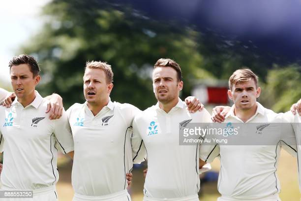Neil Wagner and Tom Blundell of New Zealand stand for the national anthem during day one of the second Test match between New Zealand and the West...