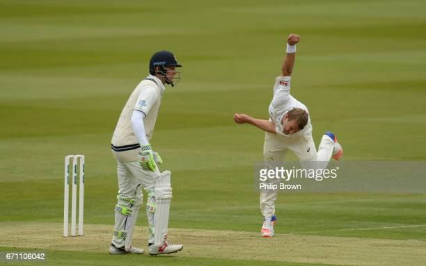 Neil Wagner of Essex bowls past Sam Robson during day one of the Specsavers County Championship Division One cricket match between Middlesex and...