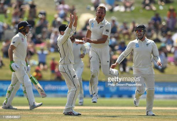 Neil Wagner of New Zealand celebrates after bowling Jos Buttler during day five of the first Test match between New Zealand and England at Bay Oval...