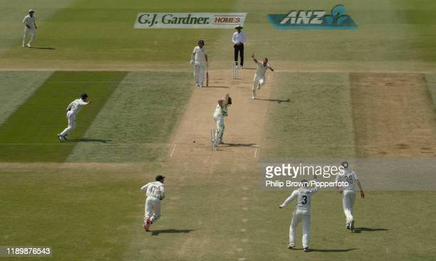 Neil Wagner of New Zealand celebrates after bowling Jos Buttler of England during the fifth day of the first Test match between New Zealand and...