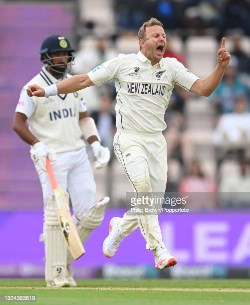 Neil Wagner of New Zealand celebrates after dismissing Shuman Gill of India as Cheteshwar Pujara looks on during Day 2 of the ICC World Test...