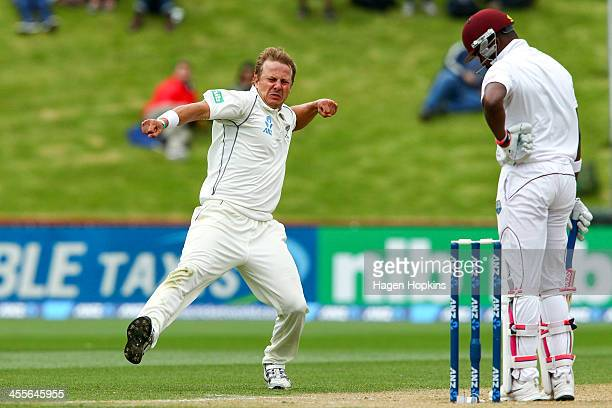 Neil Wagner of New Zealand celebrates after taking the wicket of Darren Bravo of the West Indies during day three of the Second Test match between...