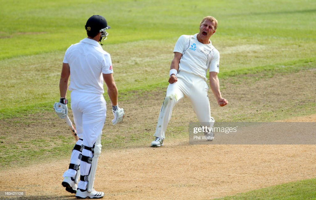 Neil Wagner of New Zealand celebrates his LBW of Nick Compton of England (L) during day five of the First Test match between New Zealand and England at University Oval on March 10, 2013 in Dunedin, New Zealand.