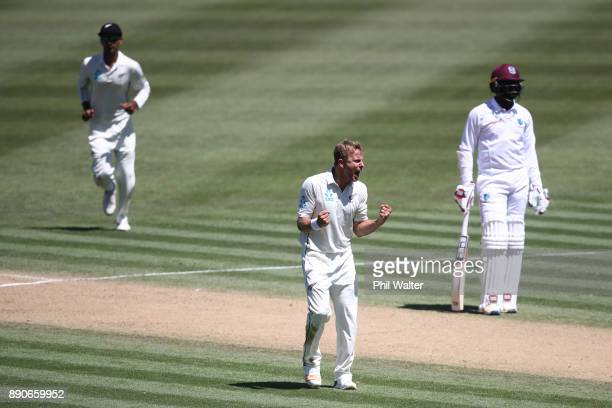 Neil Wagner of New Zealand celebrates his wicket of Roston Chase of the West Indies during day four of the Second Test Match between New Zealand and...