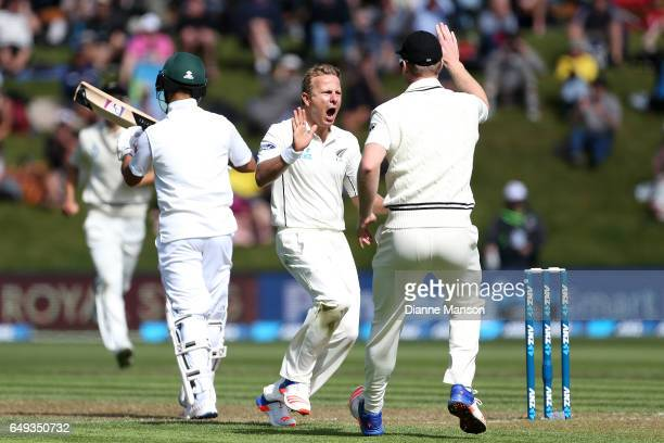 Neil Wagner of New Zealand celebrates the dismissal of JP Duminy of South Africa during day one of the First Test match between New Zealand and South...