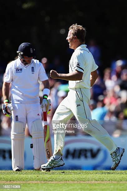 Neil Wagner of New Zealand celebrates the wicket of Ian Bell of England during day two of the First Test match between New Zealand and England at...
