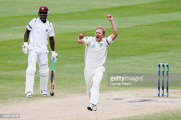 Neil Wagner of New Zealand celebrates the wicket of Shane Shillingford of the West Indies during day five of the first test match between New Zealand...