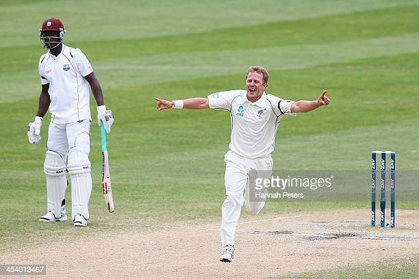 Neil Wagner of New Zealand celebrates the wicket of Tino Best of the West Indies during day five of the first test match between New Zealand and the...