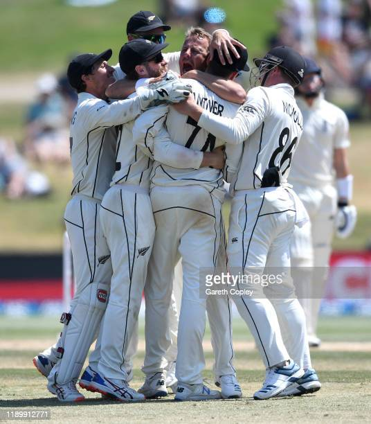 Neil Wagner of New Zealand celebrates with teammates after dismissing Ollie Pope of England during day five of the first Test match between New...