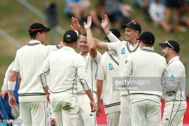 Neil Wagner of New Zealand celebrates with teammates after taking the wicket of Mahmudullah of Bangladesh during day five of the second test match in...