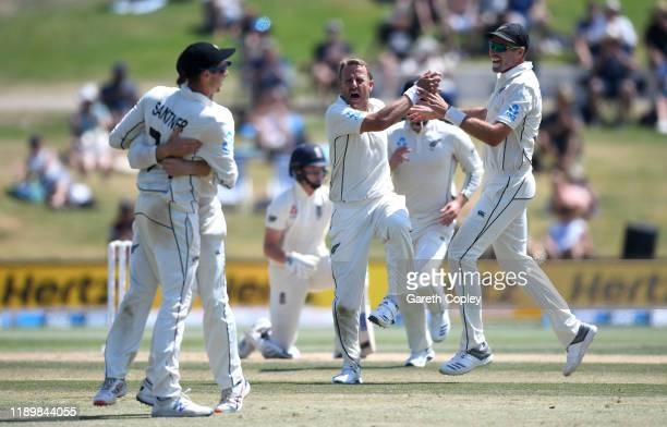 Neil Wagner of New Zealand celebrates with Tim Southee after dismissing Ollie Pope of England during day five of the first Test match between New...