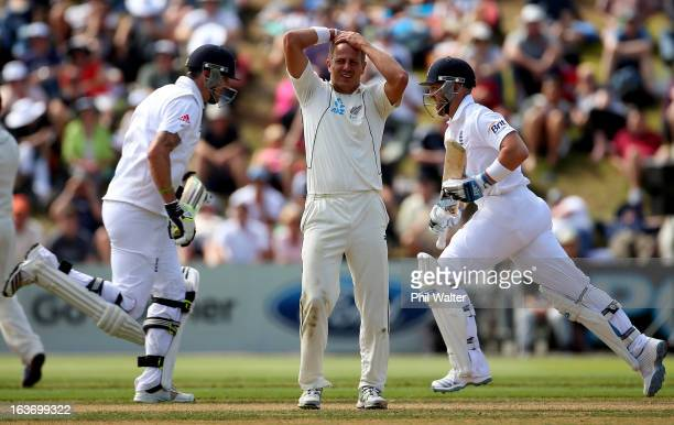 Neil Wagner of New Zealand holds his hands to his head as Kevin Pietersen of England and Matt Prior makes runs during day two of the second Test...