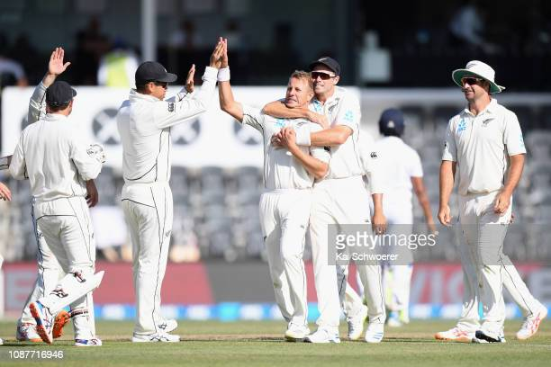 Neil Wagner of New Zealand is congratulated by team mates after dismissing Roshene Silva of Sri Lanka during day four of the Second Test match in the...