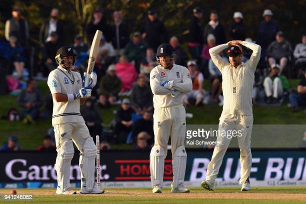 Neil Wagner of New Zealand looks on while Jonny Bairstow of England and Dawid Malan of England react during day five of the Second Test match between...