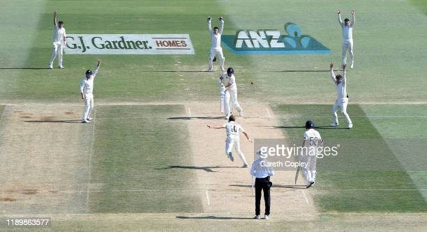Neil Wagner of New Zealand takes the final wicket of Stuart Broad of England to win the first Test match between New Zealand and England at Bay Oval...