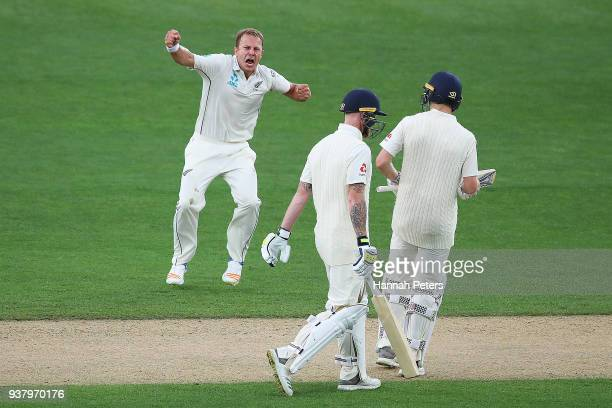 Neil Wagner of the Black Caps celebrates after claiming the wicket of Ben Stokes of England during day five of the First Test match between New...