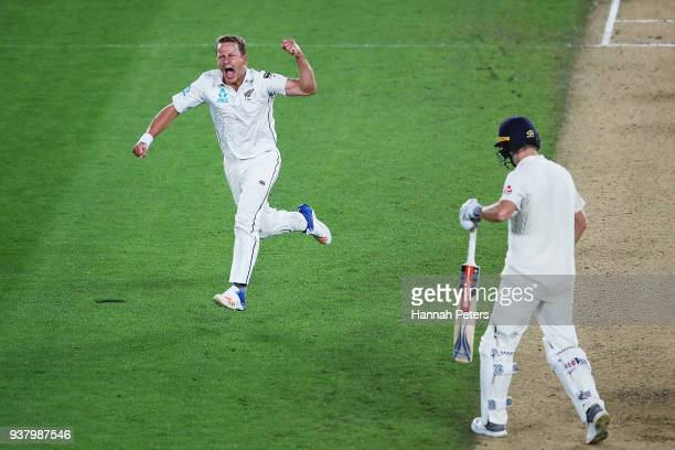 Neil Wagner of the Black Caps celebrates after claiming the wicket of Chris Woakes of England during day five of the First Test match between New...
