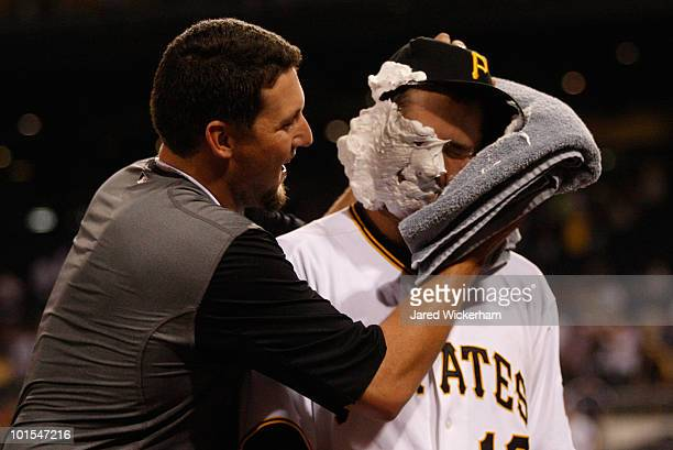 Neil Walker is hit in the face with shaving cream pie by teammate Joel Hanrahan of the Pittsburgh Pirates after a win against the Chicago Cubs on...