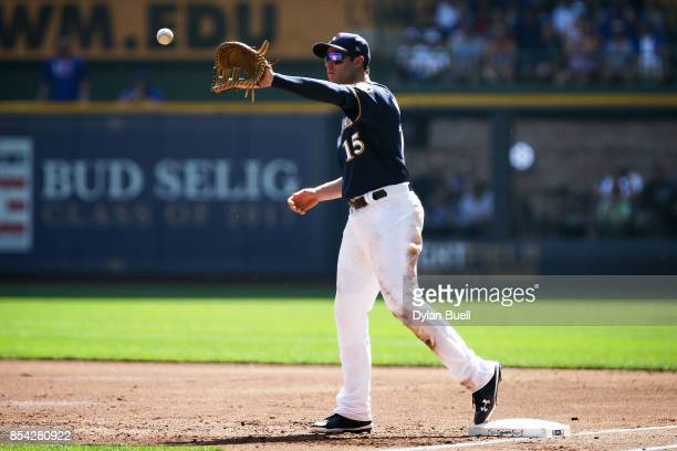 Neil Walker of the Milwaukee Brewers receives a throw at first base in the second inning against the Chicago Cubs at Miller Park on September 23 2017...