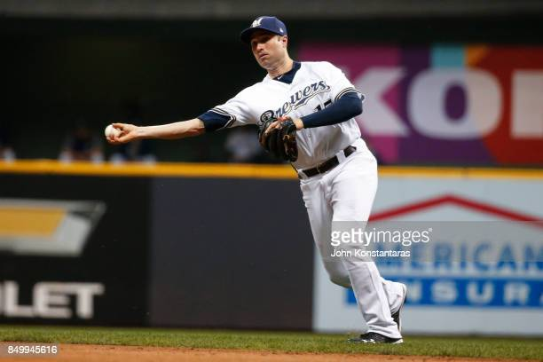 Neil Walker of the Milwaukee Brewers throws out JT Realmuto of the Miami Marlins during the seventh inning at Miller Park on September 16 2017 in...