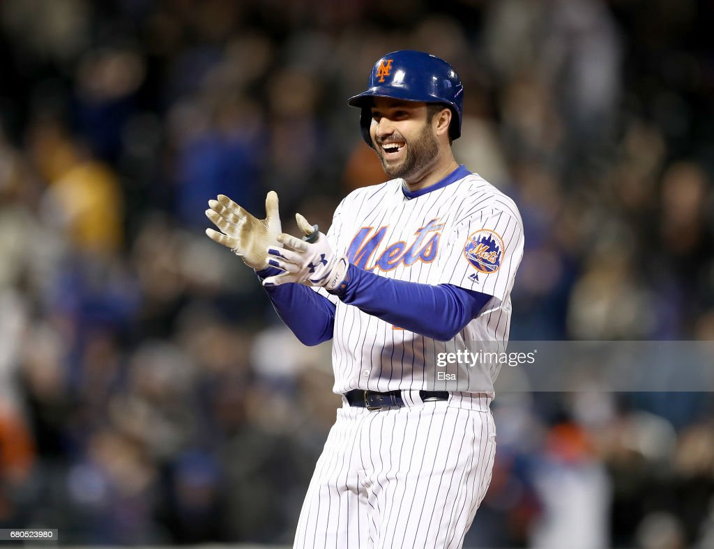 Neil Walker #20 of the New York Mets celebrates after he drove in the game winning run in the ninth inning against the San Francisco Giants on May 8, 2017 at Citi Field in the Flushing neighborhood of the Queens borough of New York City.