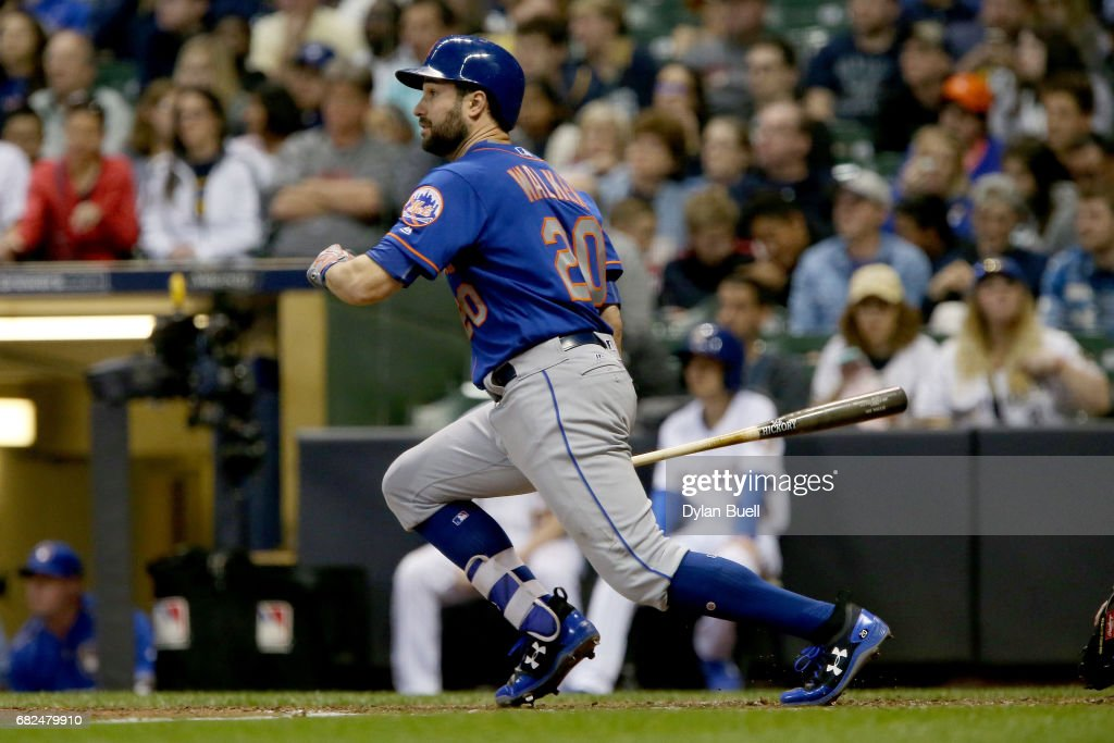 Neil Walker #20 of the New York Mets hits a single in the sixth inning against the Milwaukee Brewers at Miller Park on May 12, 2017 in Milwaukee, Wisconsin.