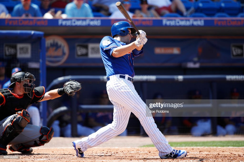 Neil Walker #20 of the New York Mets hits a two-run double in the second inning of a Grapefruit League spring training game against the Miami Marlins at Tradition Field on March 22, 2017 in Port St. Lucie, Florida. The Marlins defeated the Mets 15-9.
