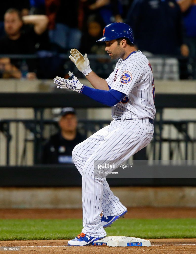 Neil Walker #20 of the New York Mets reacts at third base after his fifth inning RBI triple against the Pittsburgh Pirates at Citi Field on June 2, 2017 in the Flushing neighborhood of the Queens borough of New York City.