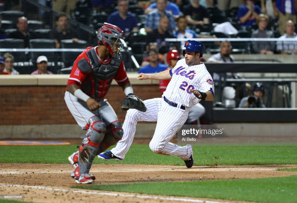 Neil Walker #20 of the New York Mets scores a run against the Los Angeles Angels in the seventh inning during their game at Citi Field on May 19, 2017 in New York City.