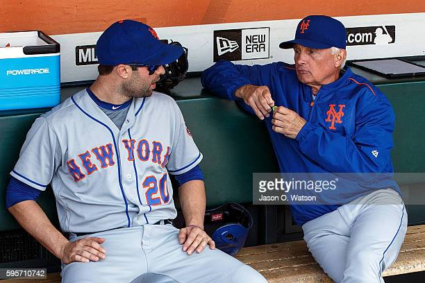 Neil Walker of the New York Mets talks to manager Terry Collins in the dugout before the game against the San Francisco Giants at ATT Park on August...