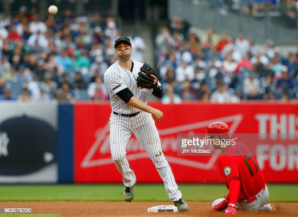 Neil Walker of the New York Yankees completes a fourth inning ending double play after forcing out Shohei Ohtani of the Los Angeles Angels of Anaheim...