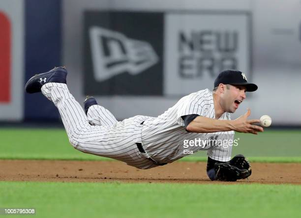 Neil Walker of the New York Yankees fields a hit by Alex Gordon of the Kansas City Royals in the ninth inning at Yankee Stadium on July 26 2018 in...