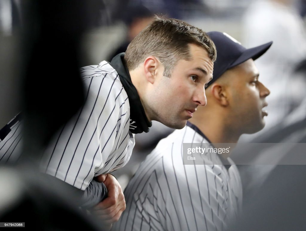 Neil Walker #14 of the New York Yankees looks on from the bench as the New York Yankees lose to the Miami Marlins at Yankee Stadium on April 17, 2018 in the Bronx borough of New York City.The Miami Marlins defeated the New York Yankees 9-1.