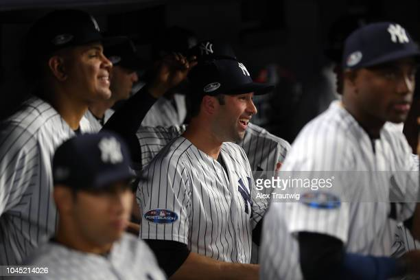 Neil Walker of the New York Yankees looks on from the dugout during the American League Wild Card game against the Oakland Athletics at Yankee...
