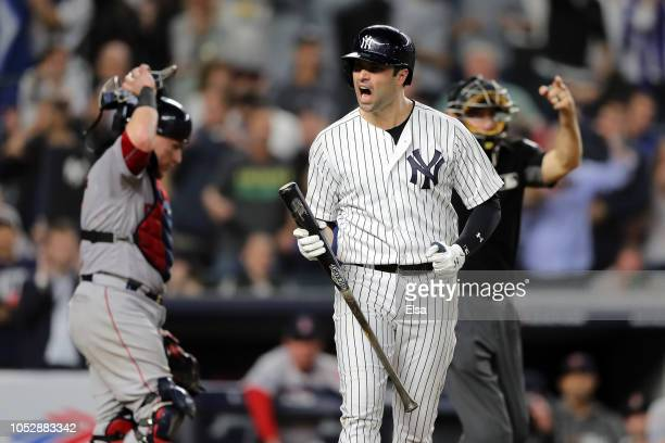 Neil Walker of the New York Yankees reacts after getting hit by a pitch to bring in a run in the ninth inning against the Boston Red Sox during Game...