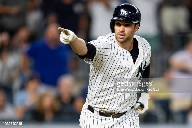 Neil Walker of the New York Yankees reacts after hitting a go ahead three run home run during the seventh inning of a game against the Boston Red Sox...