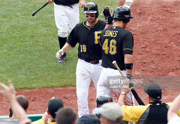 Neil Walker of the Pittsburgh Pirates celebrates after hitting a sacrifice fly in the seventh inning against the Miami Marlins during the game on...