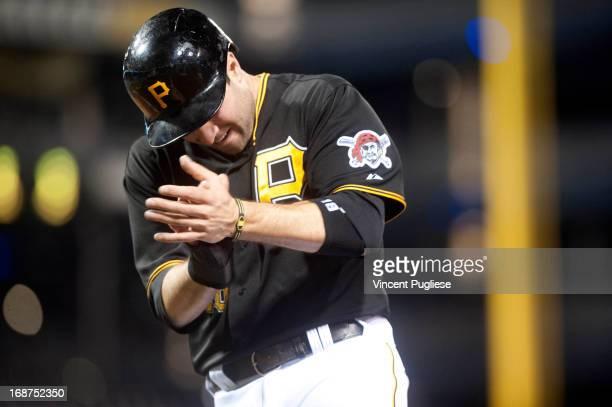 Neil Walker of the Pittsburgh Pirates celebrates after scoring to tie the game with the Milwaukee Brewers 33 in the eighth inning at PNC Park on May...