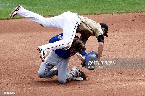 Neil Walker of the Pittsburgh Pirates collides with Joe Mather of the Chicago Cubs after turning a double play during the game on May 27 2012 at PNC...