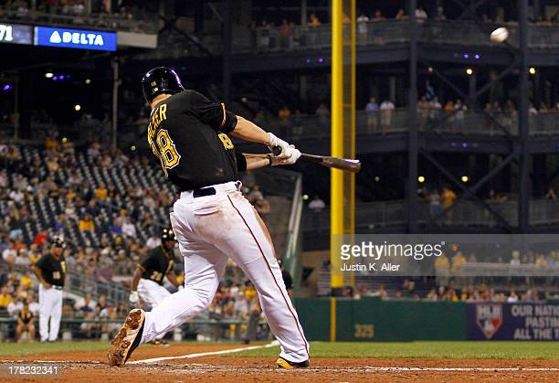 Neil Walker of the Pittsburgh Pirates hits a three run home run in the fifth inning against the Milwaukee Brewers during the game on August 27 2013...