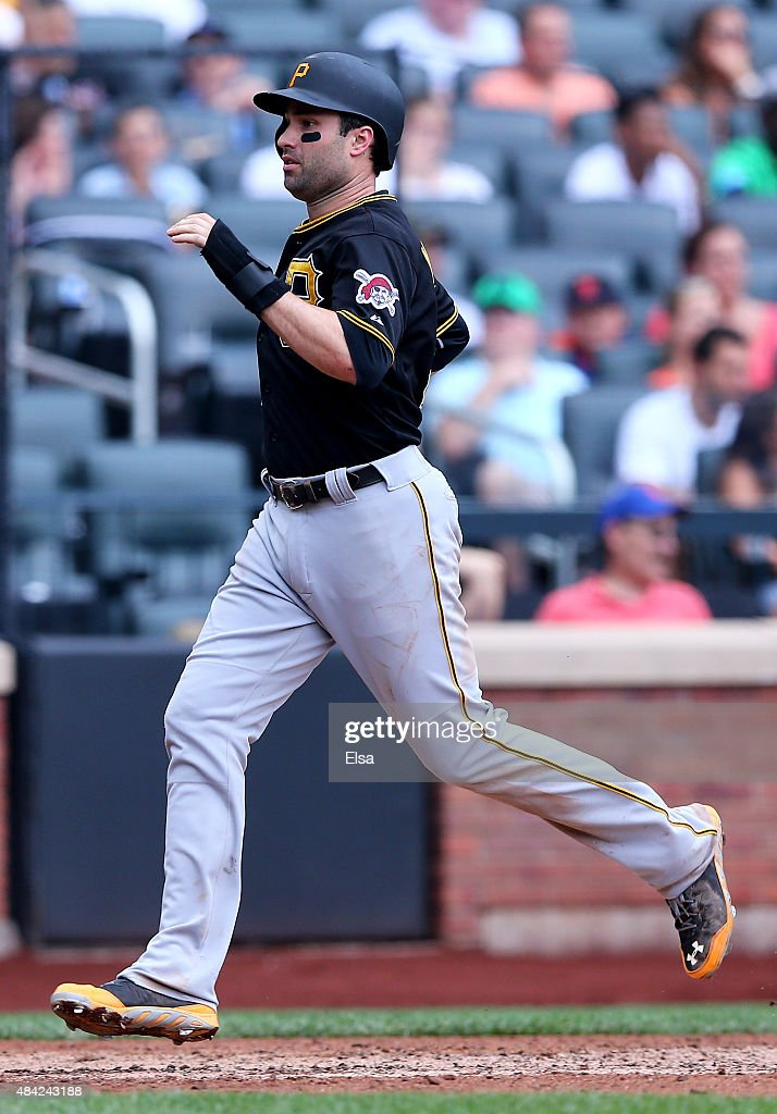 Neil Walker #18 of the Pittsburgh Pirates scores in the eighth inning against the New York Mets on August 16, 2015 at Citi Field in the Flushing neighborhood of the Queens borough of New York City.The Pittsburgh Pirates defeated the New York Mets 8-1.