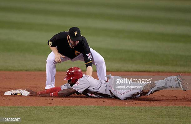 Neil Walker of the Pittsburgh Pirates tags out Brandon Phillips of the Cincinnati Reds during the game on September 23 2011 at PNC Park in Pittsburgh...