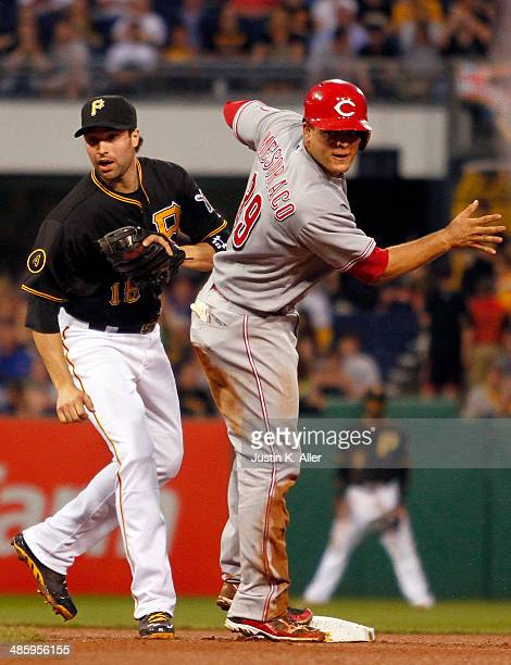 Neil Walker of the Pittsburgh Pirates tags out Devin Mesoraco of the Cincinnati Reds in the fourth inning during the game at PNC Park April 21 2014...