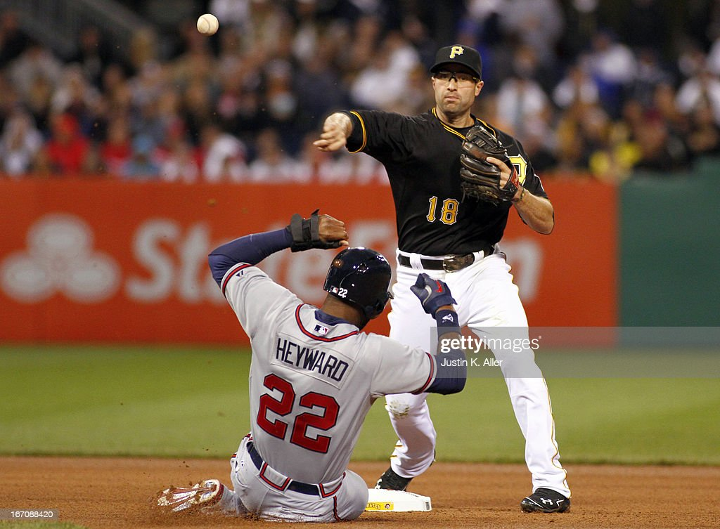 Neil Walker #18 of the Pittsburgh Pirates turns a double play in the fourth inning against the Atlanta Braves during the game on April 19, 2013 at PNC Park in Pittsburgh, Pennsylvania.