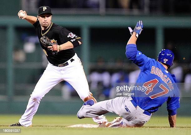 Neil Walker of the Pittsburgh Pirates turns a game ending double play in front of Brian Bogusevic of the Chicago Cubs on September 14 2013 at PNC...