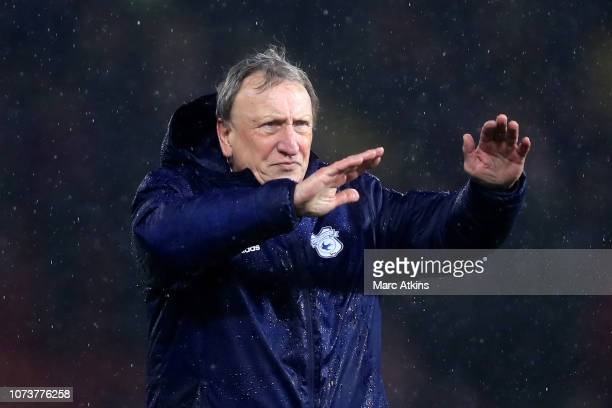 Neil Warnock Manager of Cardiff City acknowledges the fans after the Premier League match between Watford FC and Cardiff City at Vicarage Road on...