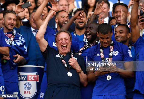 Neil Warnock Manager of Cardiff City and his team celebrate with his team as they gain promotion to the premier league during the Sky Bet...